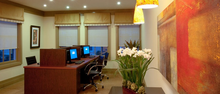 E-Lounge with computers, desks, chairs and printers at the 100 Park at Wyomissing Square apartment community